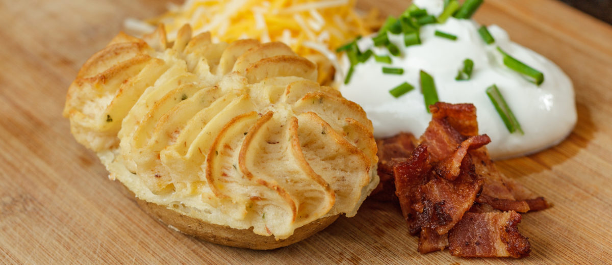photo of twice baked potato with bacon cheese and sour cream