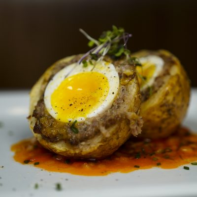 photo of scotch egg potato skins